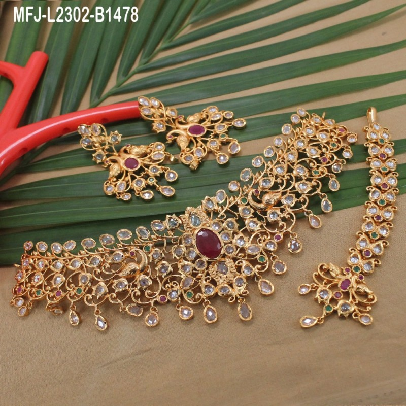 CZ & Ruby Stones Flowers, Leaves & Thilakam Design With Pearl Drop Gold Plated Finish Jumki Buy Online
