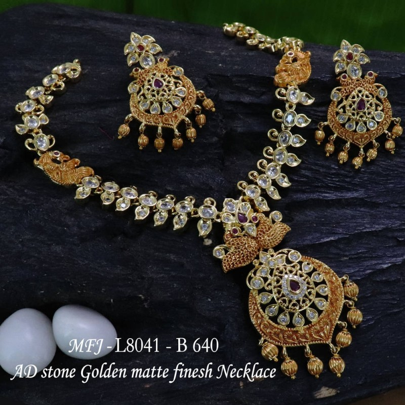 Ruby Stones Flowers & 4 Step Design Gold Plated Finish Jumki Buy Online