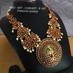 Ruby&Emerald Stoned With Golden Balls lakshmi With Peacock Design Matte Plated Finished Haram Set Buy Online