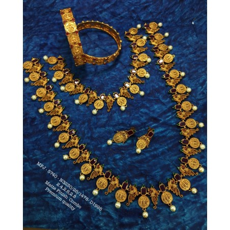 Ruby,Emerald Stoned With Golden Ball Lakshmi Design Mat Plated Finished Haram Set Buy Online