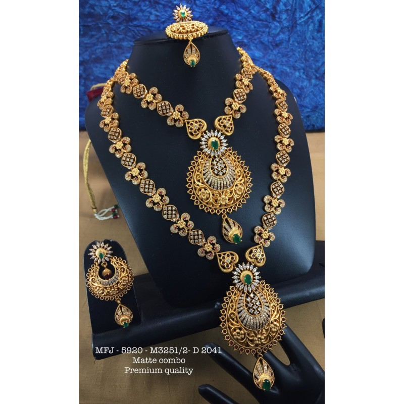Ruby,Emerald Stoned With Golden Ball Peacock With Flower Design Mat Plated Finished Haram Set Buy Online
