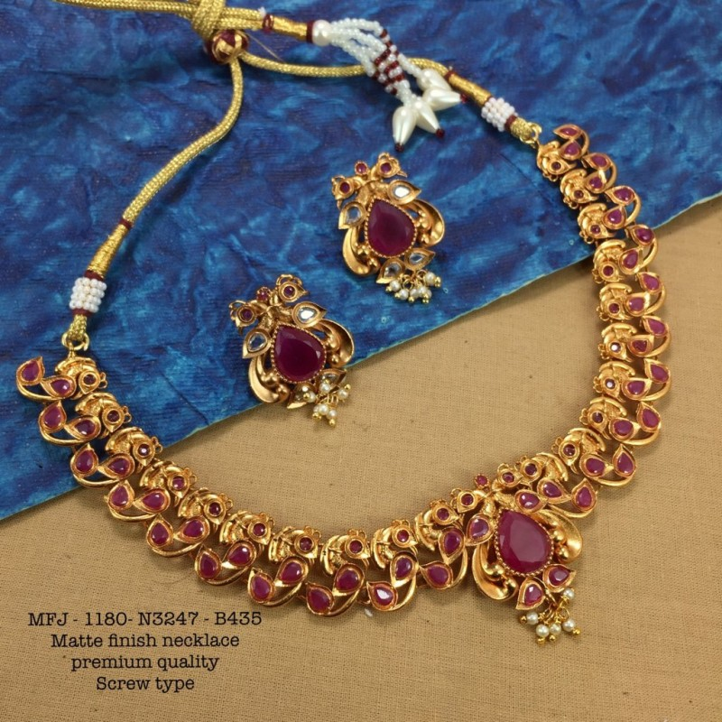 Ruby Stoned With Golden Matte Balls And Flower Design Mat Plated Finished Haram Set Buy Online