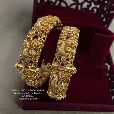 Ruby,Emerald Stoned With Pearls lakshmi&Flower Jumka Design  Matte Finish Set Buy Online