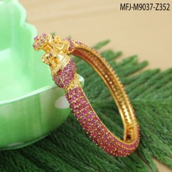 CZ & Ruby Stones With Pearl Drop Leaves & Thilakam Design Gold Plated Finish Jumki Buy Online