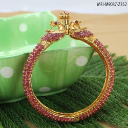 CZ & Ruby Stones With Pearls Drop Leaves & Thilakam Design Gold Plated Finish Jumki Buy Online