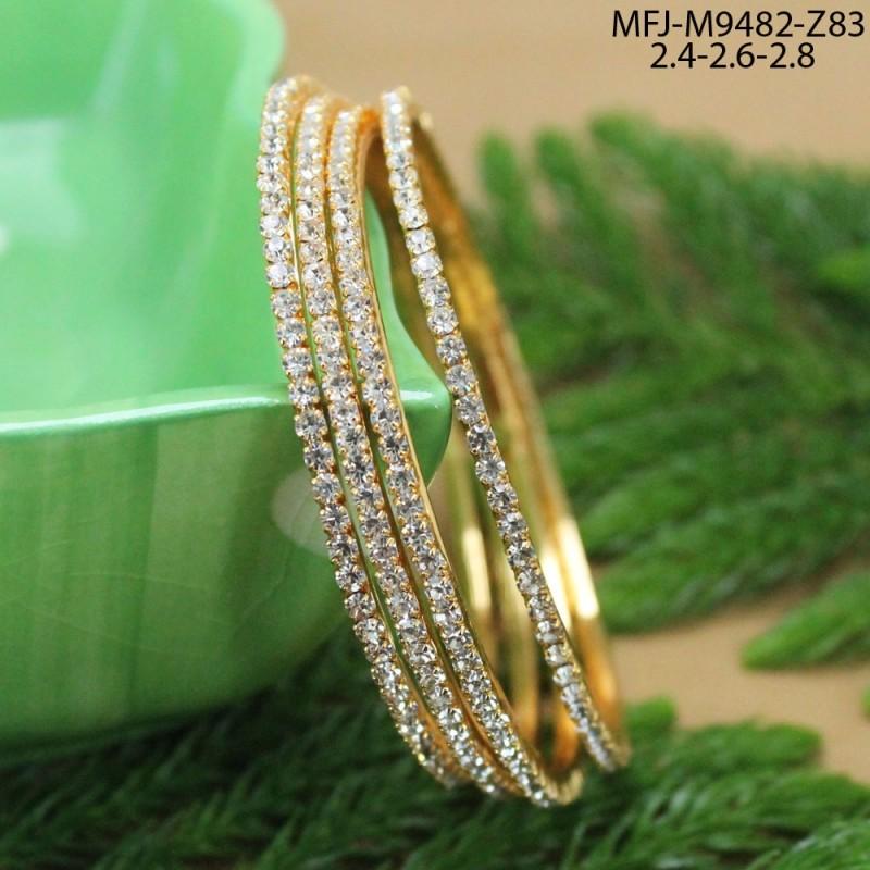 CZ, Ruby & Emerald Stones Lord Ganesh Design Gold Plated Finish Rakhi Buy Online