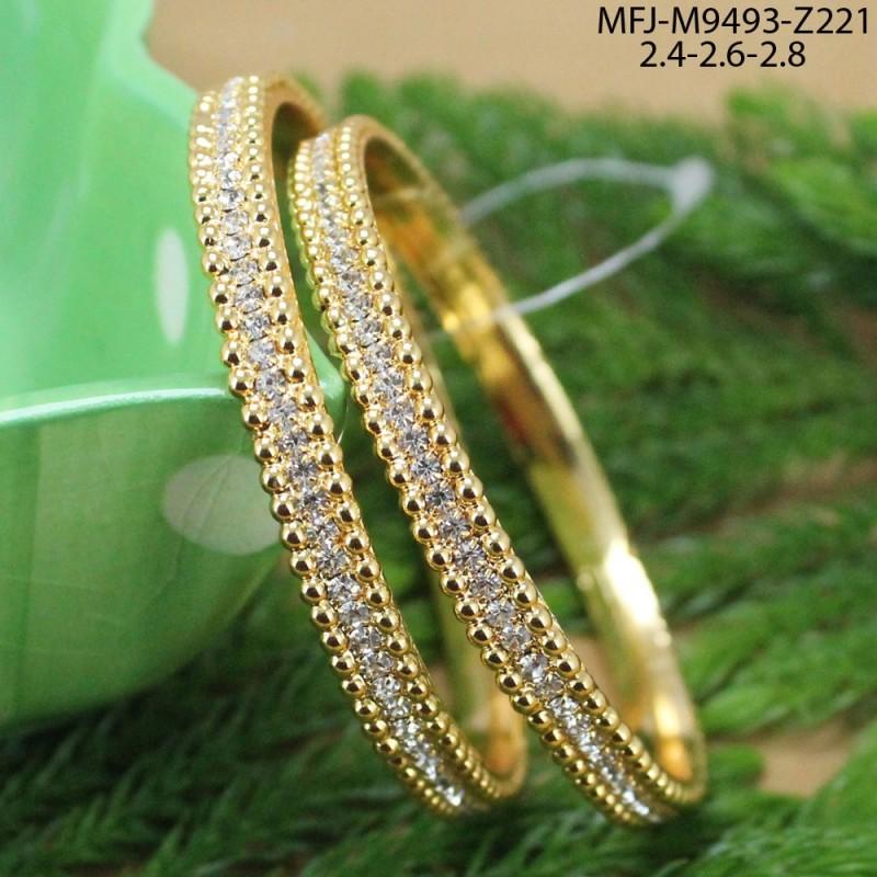 CZ & Ruby Stones OM Design Gold Plated Finish Rakhi Buy Online