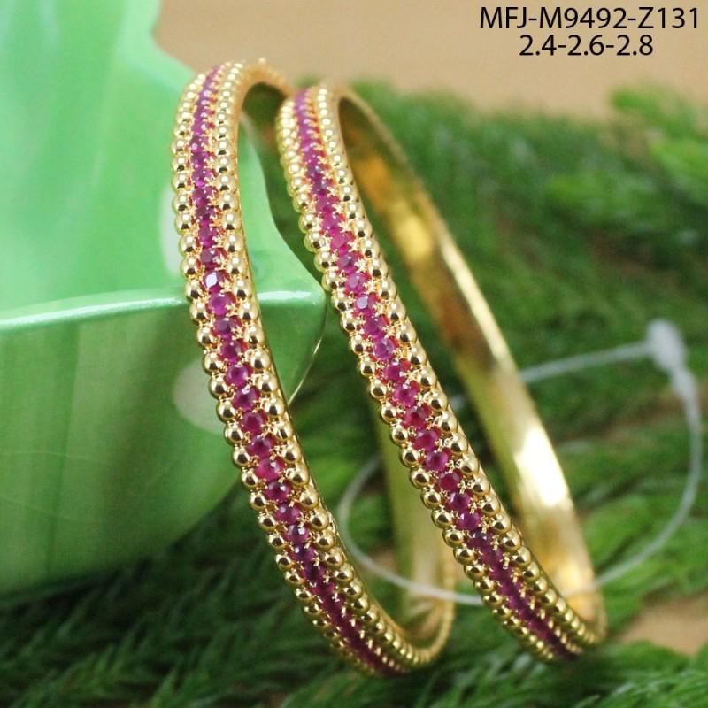 CZ, Ruby & Emerald Stones Vel, Flowers & Leaves Design Gold Plated Finish Rakhi Buy Online