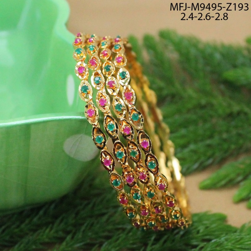 CZ, Ruby & Emerald Stones Peacock & Thilakam Design With Pearls Drops Gold Plated Finish Pendant Set Buy Online