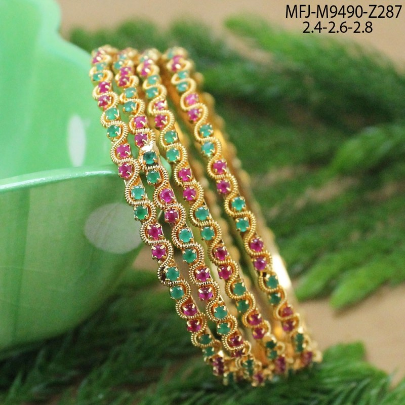 CZ, Ruby & Emerald Stones Lakshmi & Leaves Design With Pearls Drops Gold Plated Finish Pendant Set Buy Online