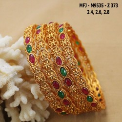 CZ, Ruby & Emerald Stones Flowers, Peacock & Thilakam Design With Emerald Drop Gold Plated Finish Headset Buy Online
