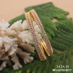CZ, Ruby, Emerald & Kempu Stones Lakshmi, Peacock & Flowers Design With Pearls Drops Mat Finish Haram Set Buy Online