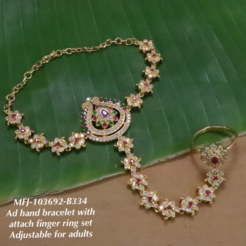 CZ,Ruby&Emerald Stones Flower Design Gold Finish Bracelet With Attached Ring Set Buy Online